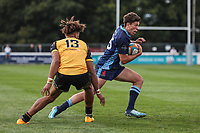 Joe Luca Smith of London Scottish (right) looks for a way past Guy Armitage of Ealing Trailfinders during the Greene King IPA Championship match between London Scottish Football Club and Ealing Trailfinders at Richmond Athletic Ground, Richmond, United Kingdom on 8 September 2018. Photo by David Horn.