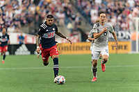 FOXBOROUGH, MA - JULY 25: Gustavo Bou #7 of New England Revolution dribbles down the wing as Lassi Lappalainen #21 of CF Montreal closes during a game between CF Montreal and New England Revolution at Gillette Stadium on July 25, 2021 in Foxborough, Massachusetts.