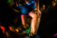 A Salvadoran sex worker sits at the table while waiting for customers in a sex club in San Salvador, El Salvador, 13 November 2016. Sex workers' task in the club is to be an entertaining and seductive companion. Performing erotic dance on the pole they make the customers stay as long as possible and buy relatively expensive alcoholic beverages from which they have a certain share. Sex workers are not obliged to have sexual intercourse with the club customers, they decide themselves, usually according to their current economic situation.