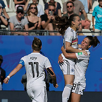 GRENOBLE, FRANCE - JUNE 22: Sara Daebritz #13 of the German National Team celebrates her penalty kick goal with teammates during a game between Panama and Guyana at Stade des Alpes on June 22, 2019 in Grenoble, France.