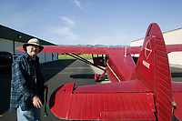 Logan Boles prepares to fly his Stinson at the Petaluma Municipal Airport, Petaluma, Sonoma County, California
