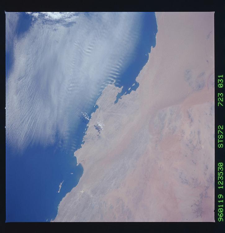 John Angerson. STS-72 Book.<br /> Public Domain Image.<br /> NASA images Courtesy National Archives - Record Group number: 255-STS-STS072<br /> Description: Earth observations taken from shuttle orbiter Endeavour during STS-72 mission.<br /> <br /> Subject Terms: STS-72, ENDEAVOUR (ORBITER), EARTH OBSERVATIONS (FROM SPACE)<br /> <br /> Date Taken: 1/19/1996<br /> <br /> Categories: Earth Observations<br /> <br /> Interior_Exterior: Exterior<br /> <br /> Ground_Orbit: On-orbit<br /> <br /> Original: Film - 70MM CT<br /> <br /> Preservation File Format: TIFF<br /> <br /> geon: NAMIBIA<br /> <br /> feat: NAMIB DES.,ELIZABETH BAY<br /> <br /> lat: -26.5<br /> <br /> lon: 15<br /> <br /> tilt: 27<br /> <br /> cldp: 20<br /> <br /> nlat: -27.5<br /> <br /> nlon: 14<br /> <br /> dir: NE<br /> <br /> azi: 286<br /> <br /> alt: 165<br /> <br /> elev: 70