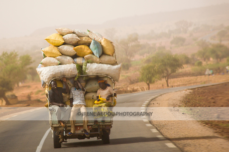 A pickup truck loaded with onions and other foodstuffs travels the road north to Niamey, capital of Niger.