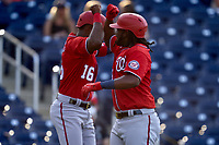 Washington Nationals Josh Bell (19) celebrates with Victor Robles (16) after hitting a home run during a Major League Spring Training game against the Houston Astros on March 19, 2021 at The Ballpark of the Palm Beaches in Palm Beach, Florida.  (Mike Janes/Four Seam Images)