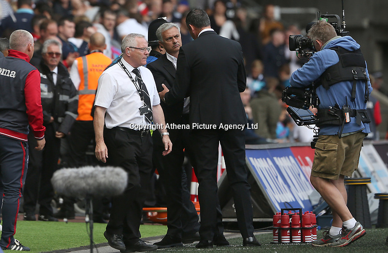 Manchester United manager Jose Mourinho shakes hands with Swansea City manager Paul Clement after the final whistle of the Premier League match between Swansea City and Manchester United at The Liberty Stadium, Swansea, Wales, UK. Saturday 18 August 2017