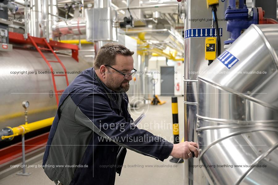 GERMANY, Hamburg, Cogeneration unit for heating and power supply with natural gas or green hydrogen / DEUTSCHLAND, Hamburg, Hansewerk Natur, BHKW Blockheizkraftwerk 1 MW Klasse, das über Kraft-Wärme-Kopplung eine Siedlung mit Strom und Wärme versorgt, Energiequellen Erdgas oder grüner Wasserstoff gewonnen aus erneuerbarer Energie