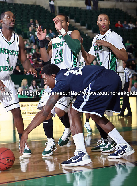 Jackson State Tigers guard De'Suan Dixon (23) scrambles for the ball in the game between the Jackson State Tigers and the University of North Texas Mean Green at the North Texas Coliseum,the Super Pit, in Denton, Texas. UNT defeated Jackson 68 to 49