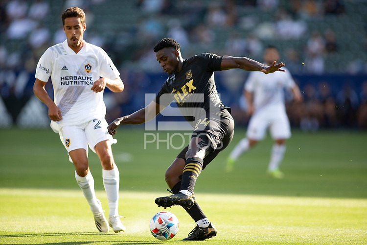 CARSON, CA - MAY 8: Jesus David Murillo #94 of LAFC turns with the ball during a game between Los Angeles FC and Los Angeles Galaxy at Dignity Health Sports Park on May 8, 2021 in Carson, California.
