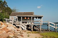 Rustic boathouse on the beach, Chatham, Cape Cod, MA, USA