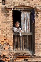 Nepal, Patan.  Little Girl in Window.