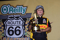 Jul. 1, 2012; Joliet, IL, USA: Son of former NHRA funny car driver Scott Kalitta celebrates with the crew of driver Jeff Arend after winning the Route 66 Nationals at Route 66 Raceway. Mandatory Credit: Mark J. Rebilas-