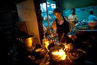Woman cooking in Bangkok, Thailand.