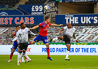 31st October 2020; Liberty Stadium, Swansea, Glamorgan, Wales; English Football League Championship Football, Swansea City versus Blackburn Rovers; Andre Ayew of Swansea City head the ball clear despite the pressure from Darragh Lenihan of Blackburn Rovers