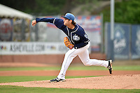 Asheville Tourists starting pitcher Alex Balog #34 delivers a pitch during a game against the  Greenville Drive at McCormick Field on May 17, 2014 in Asheville, North Carolina. The Tourists defeated the Drive 14-6. (Tony Farlow/Four Seam Images)