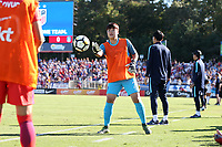 Cary, NC - Sunday October 22, 2017: Kim Minjung warms up in front of the bench during an International friendly match between the Women's National teams of the United States (USA) and South Korea (KOR) at Sahlen's Stadium at WakeMed Soccer Park. The U.S. won the game 6-0.