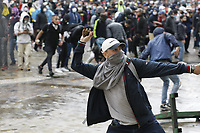 BOGOTA, COLOMBIA - APRIL 28 : A man throws a stone to police during a national strike Against the Duque package and the tax reform on April 28, 2021 in Bogota, Colombia. Colombia has the minimum wage around $ 250 per month where people are unhappy about corruption, unemployment, and inequality by Government. (Photo by Leonardo Munoz/VIEWpress)