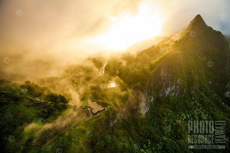 Mist rolls over the Nu'uanu Pali Lookout and Ko'olau Range at sunset on O'ahu.