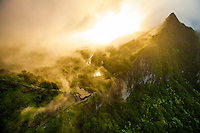 Mist rolls over the Nu'uanu Pali Lookout and Ko'olau Range at sunset on O'ahu.