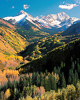 Snow-capped Capital Peak and Mount Daley on a spectacular fall evening in the Maroon Bells-Snowmass Wilderness