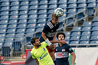 FOXBOROUGH, MA - MAY 12: Austin Panchot #12 of Union Omaha , Sean O'Hearn #40 of New England Revolution II, and Ryan Spaulding #34 of New England Revolution II battle for head ball during a game between Union Omaha and New England Revolution II at Gillette Stadium on May 12, 2021 in Foxborough, Massachusetts.