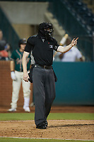 Home plate umpire Mitch Leikam asks for help in making a call during the game between the Winston-Salem Dash and the Greensboro Grasshoppers at First National Bank Field on June 3, 2021 in Greensboro, North Carolina. (Brian Westerholt/Four Seam Images)