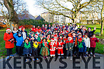 The staff and students from Moyderwell NS enjoying their Christmas Jingle Bell run in the town park on Tuesday.