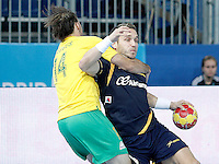 Spain's Victor Tomas Gonzalez (r) and Australia's Mitchell Hedges during 23rd Men's Handball World Championship preliminary round match.January 15,2013. (ALTERPHOTOS/Acero) /NortePhoto