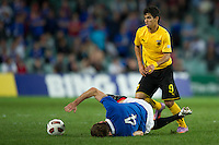 SYDNEY, AUSTRALIA - JULY 31, 2010: Kirk Broadfoot of Rangers falls heavily after a tackle during the match between AEK Athens FC and Glasgow Rangers at the 2010 Sydney Festival of Football held at the Sydney Football Stadium on July 31, 2010 in Sydney, Australia. (Photo by Sydney Low / www.syd-low.com)