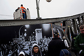Berlin, Germany<br /> November 9, 2009<br /> <br /> To mark the 20th anniversary of the fall of the Berlin wall large images, of the night the wall opened for the first time at the Bornholmer bridge, are placed on display on the same bridge.