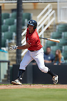 Justin Yurchak (33) of the Kannapolis Intimidators follows through on his swing against the Greensboro Grasshoppers at Kannapolis Intimidators Stadium on August 5, 2018 in Kannapolis, North Carolina. The Grasshoppers defeated the Intimidators 2-1 in game one of a double-header.  (Brian Westerholt/Four Seam Images)