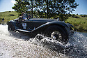 14/06/16<br /> <br /> Paul and Kate Gregory in a 1933 Alfa Romeo 8C 2300.<br /> <br /> Competitors in the Royal Automobile Club 1000 Mile Trial splash through Tissington Ford near Ashbourne in the Derbyshire Peak District. The rally saw 43 pre-war cars leave Edinburgh on Monday and finishes in Dorking, Surrey on Saturday.<br /> All Rights Reserved, F Stop Press Ltd.