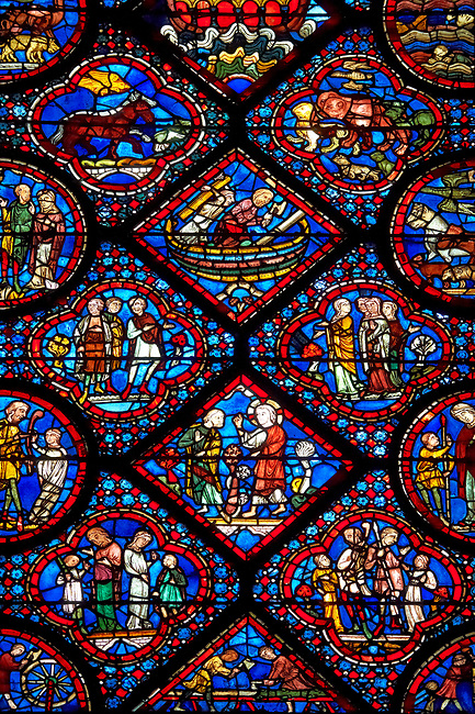 Medieval stained glass Window of the Gothic Cathedral of Chartres, France - dedicated to Noah and The Flood. Bottom Diamond panel - God instructs Noah to build an ark - The two panels below and the panels left and right show God instructing Noah to build an ark . Panel top left - Noah's sons; Shem, Ham and Japheth, panel top right - Noah's wife and daughters in law . Top central diamond - Noah and one of his sons constructing the Ark, top left  and right - Animals approaching the ark two by two. A UNESCO World Heritage Site.