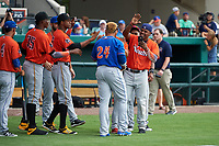 St. Lucie Mets Jhoan Urena (24) celebrates with teammates - including Brian Navarreto (right), Yunior Montero (27),  Pedro Vasquez (35) during the Home Run Derby before the Florida State League All-Star Game on June 17, 2017 at Joker Marchant Stadium in Lakeland, Florida.  FSL North All-Stars defeated the FSL South All-Stars  5-2.  (Mike Janes/Four Seam Images)