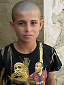 Iraq 2011 <br /> A young Yezidi boy in Lalesh shrine  <br /> Irak 2011 <br /> Un jeune yezidi au sanctuaire de Lalesh