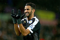 Riyad Mahrez of Leicester City celebrates scoring his goal to make the score 0-3 to complete his hattrick during the Barclays Premier League match between Swansea City and Leicester City played at The Liberty Stadium on 5th December 2015