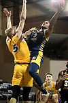SIOUX FALLS, SD - MARCH 7: Brandon McKissic #3 of the UMKC Kangaroos takes the ball tot he basket against Sam Griesel #5 of the North Dakota State Bison during the Summit League Basketball Tournament at the Sanford Pentagon in Sioux Falls, SD. (Photo by Dave Eggen/Inertia)