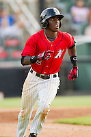 Tim Anderson (2) of the Kannapolis Intimidators hustles down the first base line against the Greensboro Grasshoppers at CMC-Northeast Stadium on July 13, 2013 in Kannapolis, North Carolina.  The Intimidators defeated the Grasshoppers 7-5.   (Brian Westerholt/Four Seam Images)