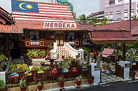 Kampung Morten House with Flags Representing Traditional Malaysian Sultanates, Melaka, Malaysia.  Merdeka means free or independent, referring to the end of British colonial rule.