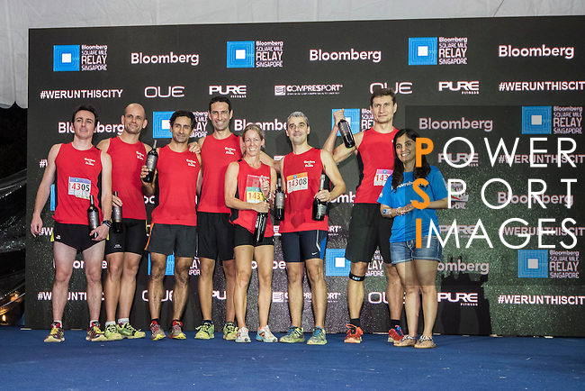 Runners participate at the Bloomberg Square Mile Relay Singapore on 3rd December 2015 at The Promontory @ Marina Bay in Singapore. Photo by Lim Weixiang / Power Sport Images