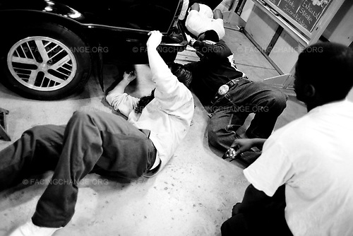 Joliet , Illinois USA. <br /> March 2010 <br /> <br /> Teens work on cars in their Automotive Class. At the juvenile Joliet maximum security youth prison.