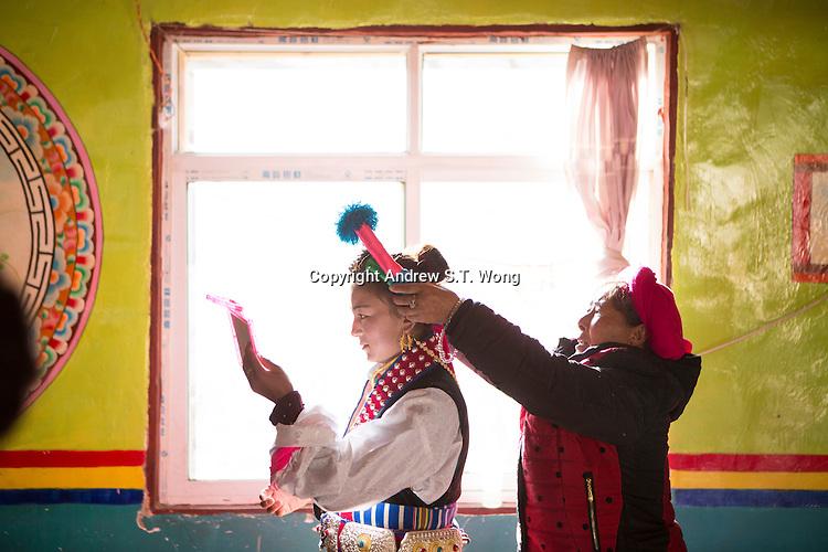 East Village, Diqing Tibetan Autonomous Prefecture, Yunnan Province, China - Tibetan girls prepare to perform traditional Xianzi Dance, February 2017.
