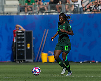GRENOBLE, FRANCE - JUNE 22: Ngozi Okobi #13 of the Nigerian National Team dribbles during a game between Panama and Guyana at Stade des Alpes on June 22, 2019 in Grenoble, France.