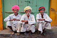 Rajasthan, India 2011.Three men in turbans, Pushkar, Rajasthan, India 2011. Thousands of people were swarming the streets heading to the banks of the Pushkar Lake for a holy dip on full moon day. I pressed myself against the wall to avoid being crushed. I looked across and these three turbaned men appeared undeterred by the crowd and somewhat entertained by my predicament. The colors are delicious in Rajasthan. So many turbans, so little time.