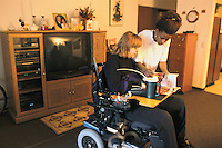 Minnesota, Minneapolis. Young woman who works at Walmart as well as a caretaker for disabled woman.