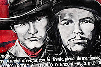 A mural, depicting Augusto César Sandino (the leader of the Nicaraguan resistance in the early 20th century) and Ernesto Che Guevara (the guerrilla leader in the Cuban Revolution), appears on the wall in Estelí, Nicaragua, 18 November 2004. The Sandinista National Liberation Front (in Spanish: Frente Sandinista de Liberación Nacional, or FSLN) is a socialist political party in Nicaragua. The FSLN is one of Nicaragua's two leading parties. Sandinistas took their name from Augusto César Sandino (1895-1934), the historical leader of Nicaragua's nationalist rebellion against the US occupation of the country in the 1930s. In 1979 the FSLN overthrew the Somoza dynasty and ruled Nicaragua from 1979 to 1990. They left power in 1990 after free elections. In 2006, the former President Daniel Ortega, the leader of the party, was re-elected President of Nicaragua.