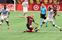 ATLANTA, GA - AUGUST 29: Jeff Larentowicz #18 of Atlanta United and Andreas Perea  #21 of Orlando City compete for the ball during a game between Orlando City SC and Atlanta United FC at Marecedes-Benz Stadium on August 29, 2020 in Atlanta, Georgia.