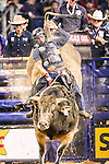 Professional Bull Riders in action during the Choctaw Casino Iron Cowboy bull riding event, at the AT & T stadium in Arlington, Texas.