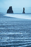 This black sand beach is a very popular stop in Iceland, which means bus loads of tourists, even in the howling wind.  Late in the evening, there is a time photographers call the blue hour.  Seth, a fellow photographer who invited me on this trip to Iceland, had great fun laughing at the tourists and photographers being caught off guard by the occasional large rogue wave.