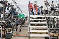 Members of the press work near the press riser before the arrival of US President Donald Trump at a Make America Great Again Victory Rally in the final week before the Nov. 3 election at Pro Star Aviation in Londonderry, New Hampshire, on Sun., Oct. 25, 2020.