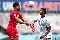 Zak Vyner of Bristol City battles with Rhian Brewster of Swansea City during the Sky Bet Championship match between Swansea City and Bristol City at the Liberty Stadium in Swansea, Wales, UK. Saturday 18 July 2020